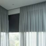 How Do I Hang Curtains Over Vertical Blinds That Stick Out?